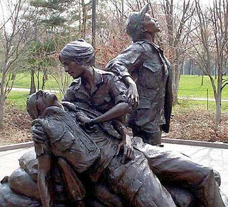 The Vietnam Women's Memorial was designed by Glenna Goodacre and dedicated on November 11, 1993. It is part of the Vietnam Veterans Memorial, and is located on National Mall in Washington DC, a short distance south of The Wall, north of the Reflecting Pool. Photo by Rudi Williams (American Forces Press Service).